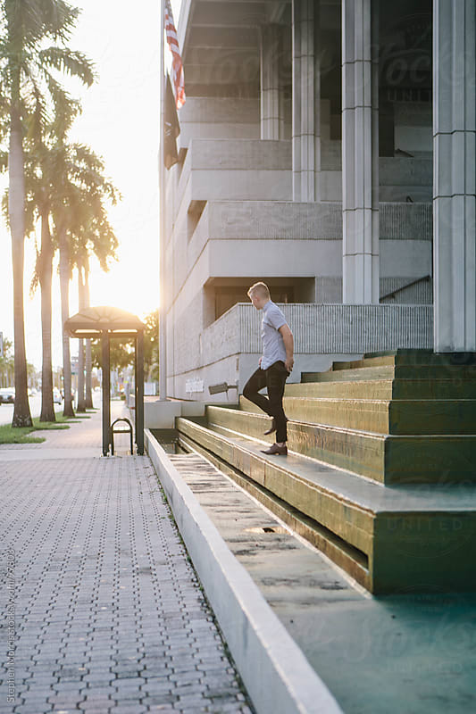 Young Man on Steps at Sunset by Stephen Morris for Stocksy United