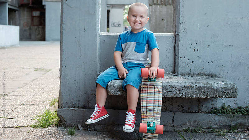 Portrait of a Little Boy with Skateboard by Branislav Jovanović for Stocksy United