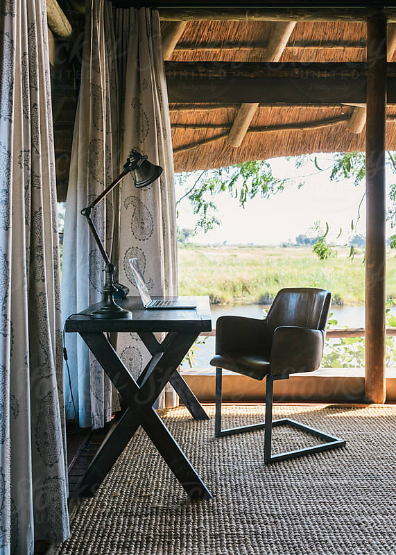 Modern workspace in African safari house by Trent Lanz for Stocksy United