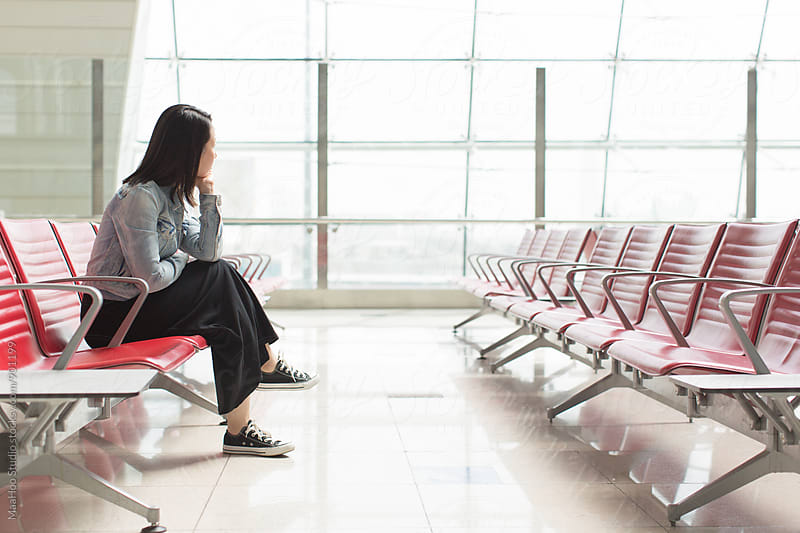 Young chinese woman in airport by MaaHoo Studio for Stocksy United