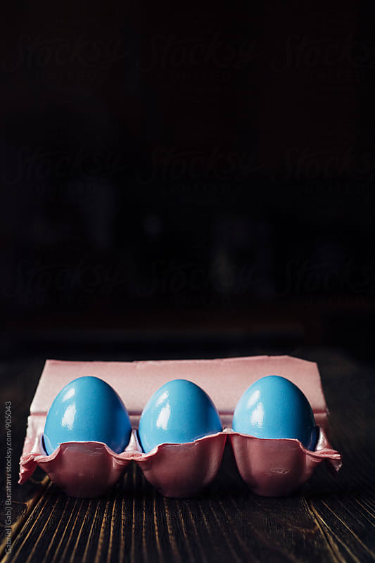 Three blue eggs in a pink carton by Gabriel (Gabi) Bucataru for Stocksy United