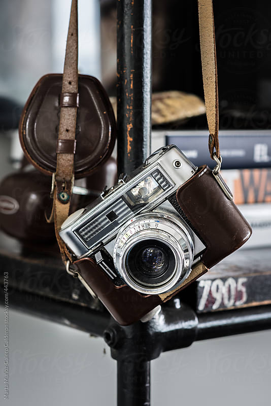 Old camera with leather case hanging by Marta Muñoz-Calero Calderon for Stocksy United