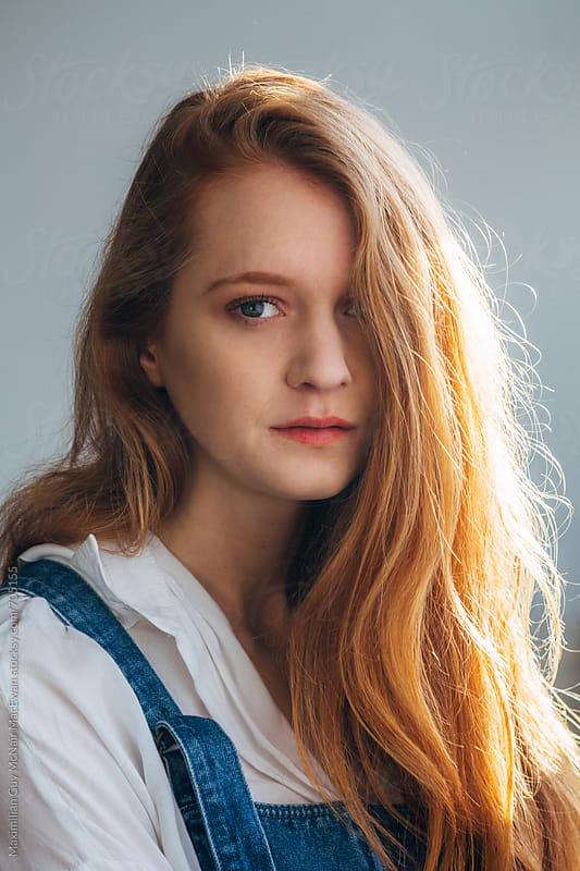 A young redhead girl in denim by Maximilian Guy McNair MacEwan for Stocksy United