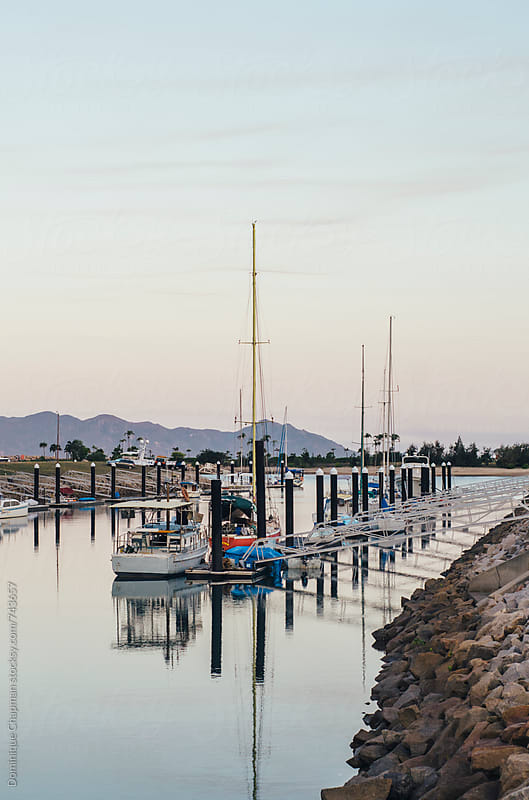 Dusk setting over a marina in Magnetic Island, Australia by Dominique Chapman for Stocksy United