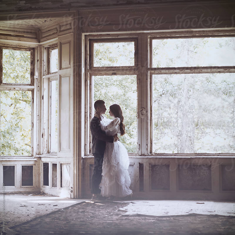 Beautiful happy couple in abandoned castle by Jovana Rikalo for Stocksy United