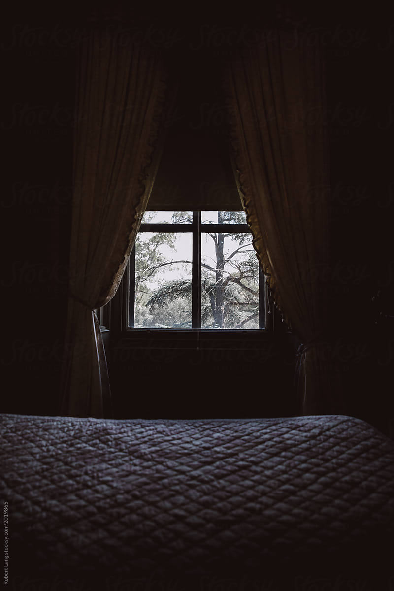 Curtains Hang Over A Large Window In An Old Dark And Gloomy Bedroom By Robert Lang Curtain Vintage Stocksy United