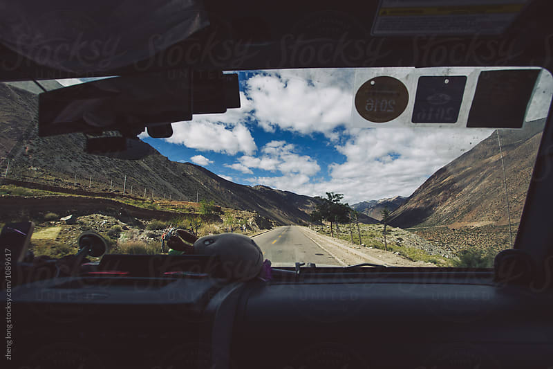 Driving on the road in Tibet  by zheng long for Stocksy United