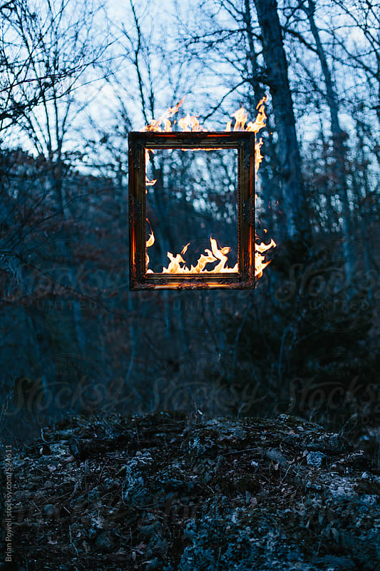 floating frame on fire by Brian Powell for Stocksy United