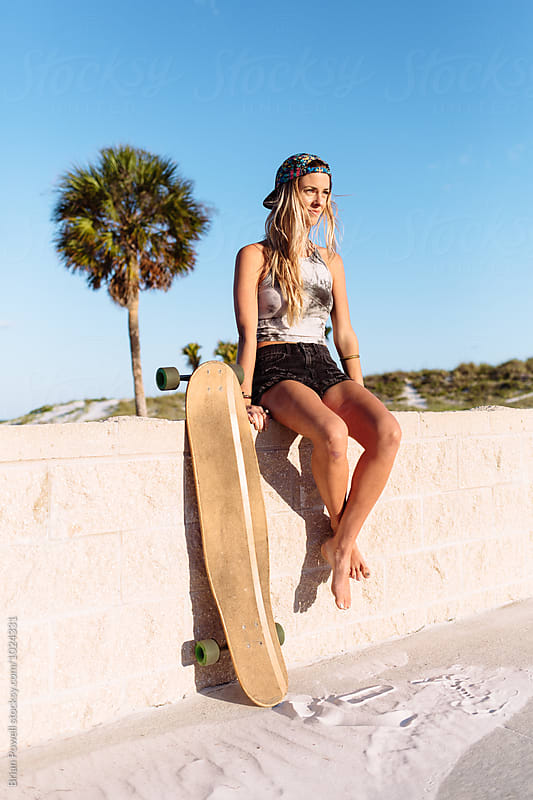 women with longboard by Brian Powell for Stocksy United