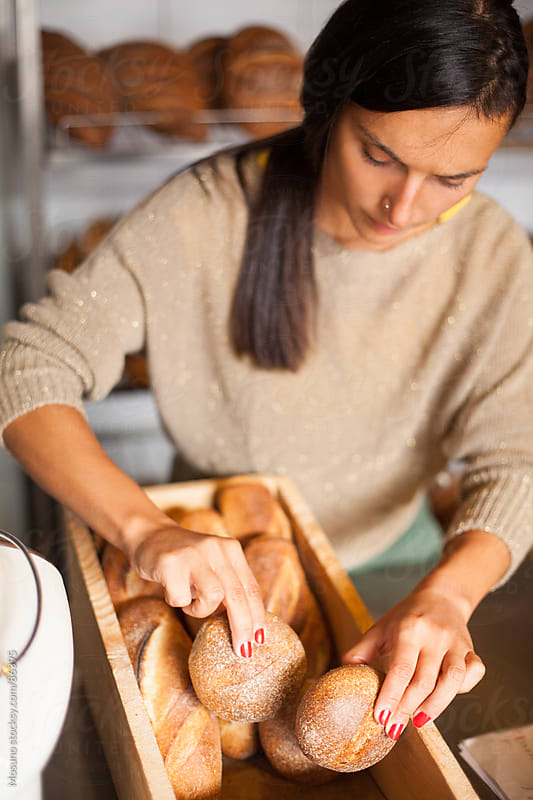 Woman Arranging Pastry in a Bakery by Mosuno for Stocksy United