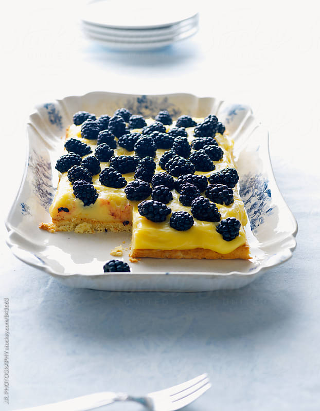 Blackberry cake with lemon cream by J.R. PHOTOGRAPHY for Stocksy United