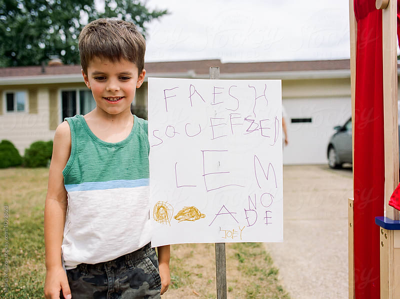 child has lemonade stand by Maria Manco for Stocksy United