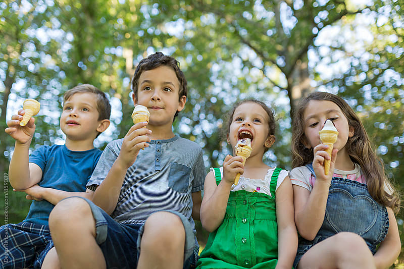 Children eating ice cream by Dejan Ristovski for Stocksy United