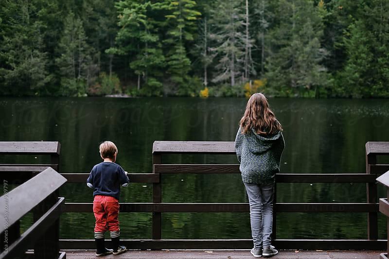 kids by lake by Léa Jones for Stocksy United