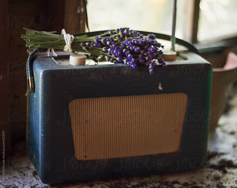 Lavender and a vintage radio by Helen Rushbrook for Stocksy United