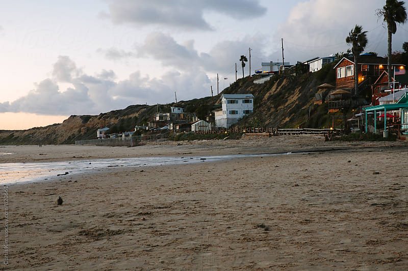 Beach homes along the coastline at the beach by Curtis Kim for Stocksy United
