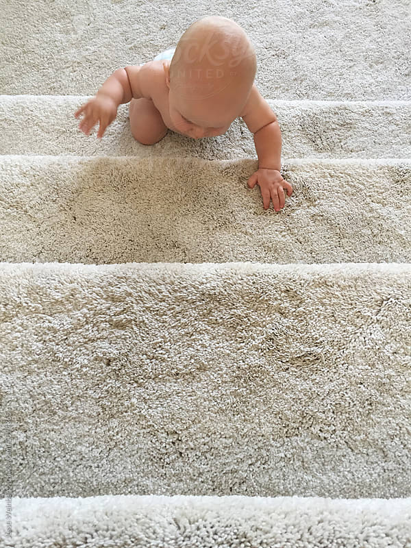 Cute Baby Climbing White Carpeted Stairs by Jesse Weinberg for Stocksy United