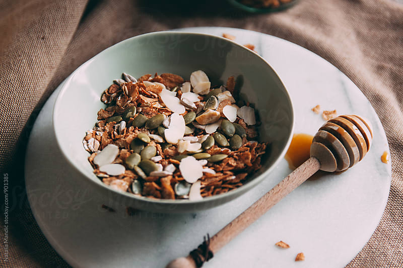 Muesli with almonds and sunflower seeds by Nataša Mandić for Stocksy United