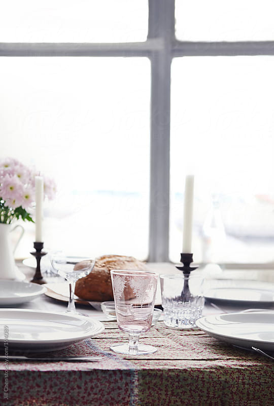 Rustic table settings by the window by Jill Chen for Stocksy United