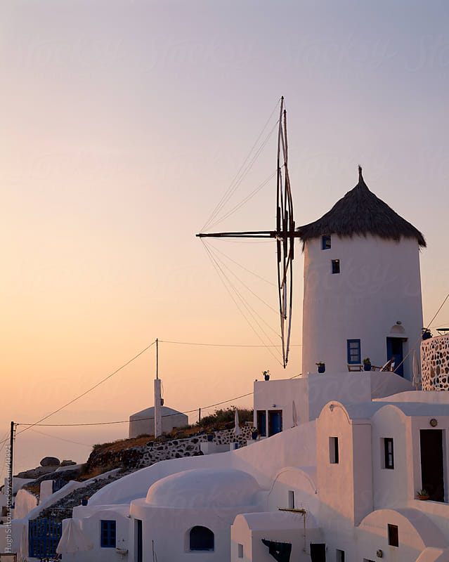 View of the windmill at Oia at sunset, Santorini by Hugh Sitton for Stocksy United