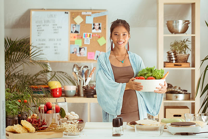 Smiling Asian Woman in Her Kitchen by Lumina for Stocksy United
