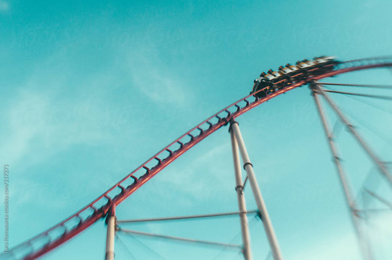 roller coaster against a blue sky by Tara Romasanta for Stocksy United