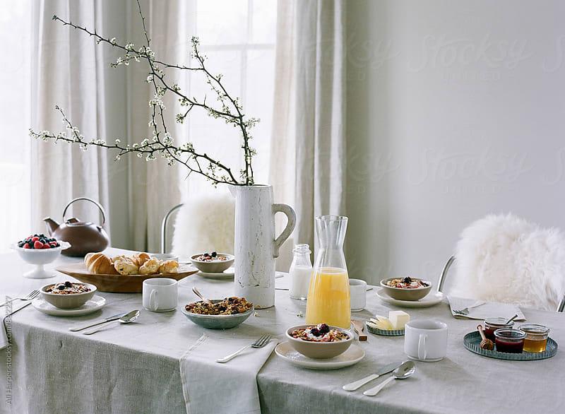 Dining room set for breakfast by Ali Harper for Stocksy United