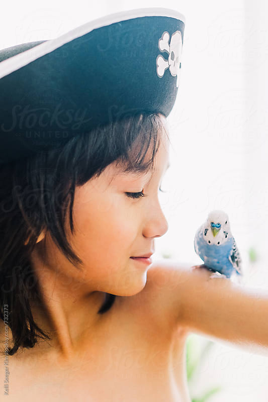 Young boy and his bird by kelli kim for Stocksy United