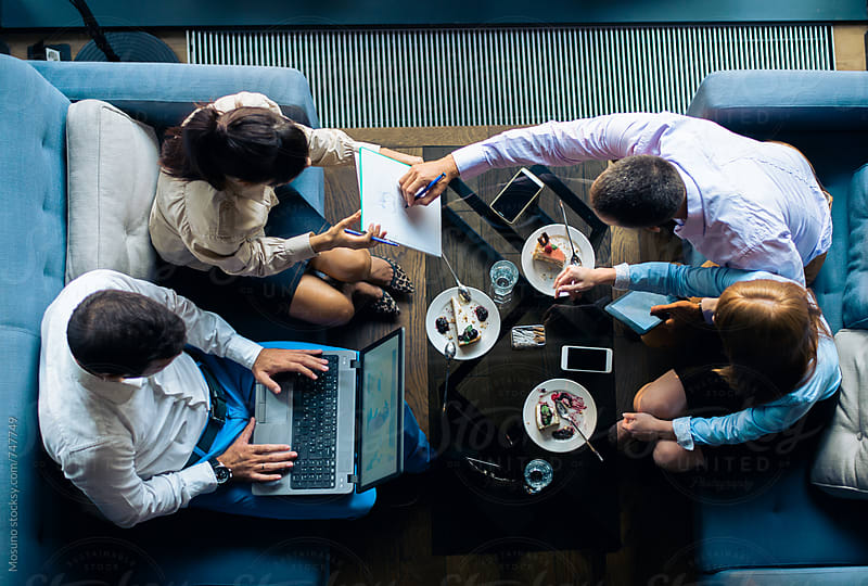 Overhead Shot of a Business Meeting by Mosuno for Stocksy United