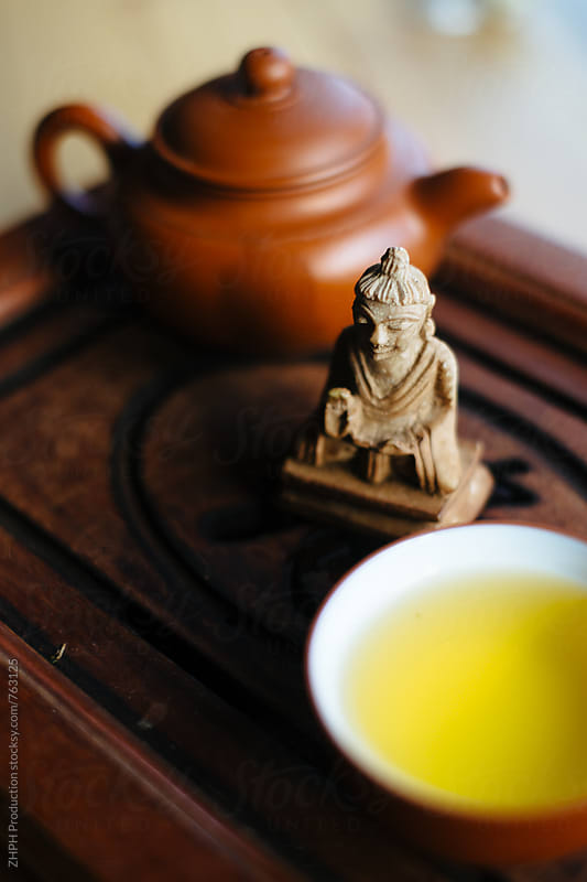 Tea with Buddha by Artem Zhushman for Stocksy United