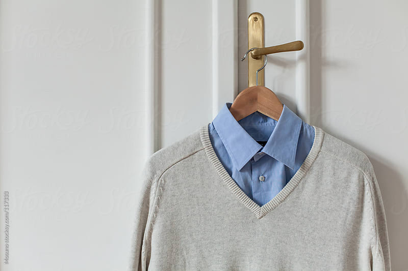 Shirt and Sweater Hanged on the Door by Mosuno for Stocksy United