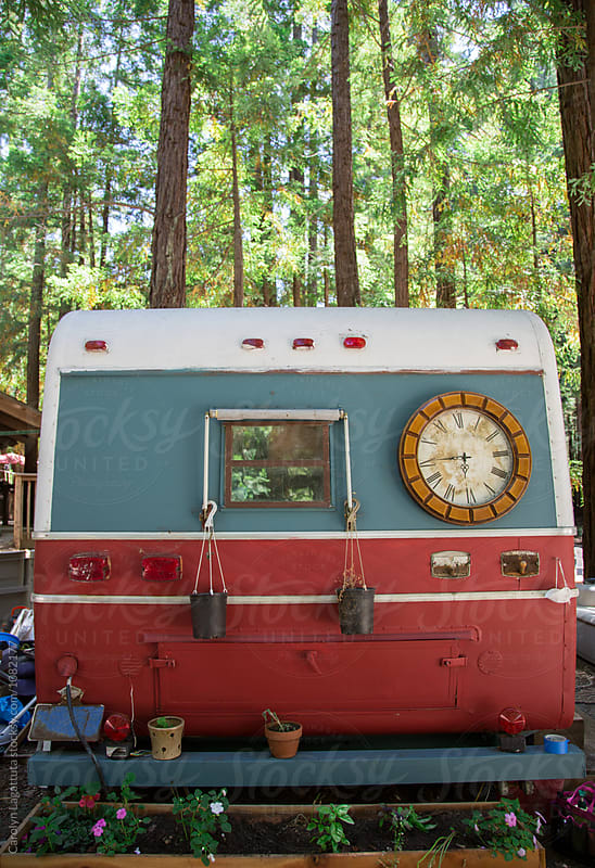 Rustic camper in the woods by Carolyn Lagattuta for Stocksy United