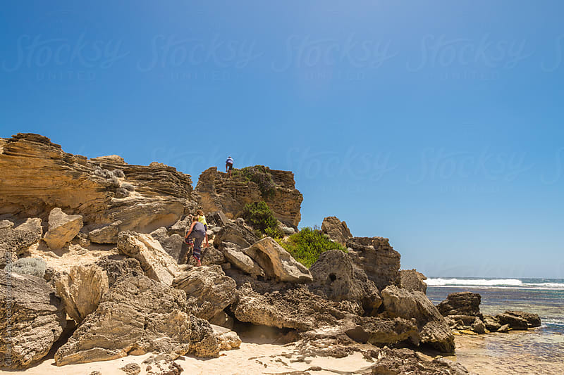rock climbing by the beach by Gillian Vann for Stocksy United