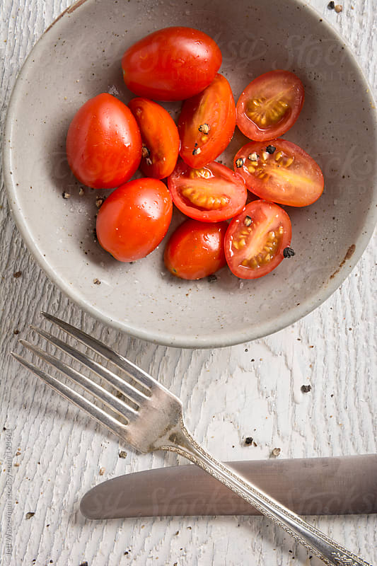 Closeup  Cherry Tomatoes in Bowl with Knife and Fork by Jeff Wasserman for Stocksy United