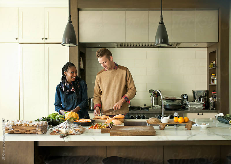 Couple Cooking Dinner in Kitchen by Jill Chen for Stocksy United