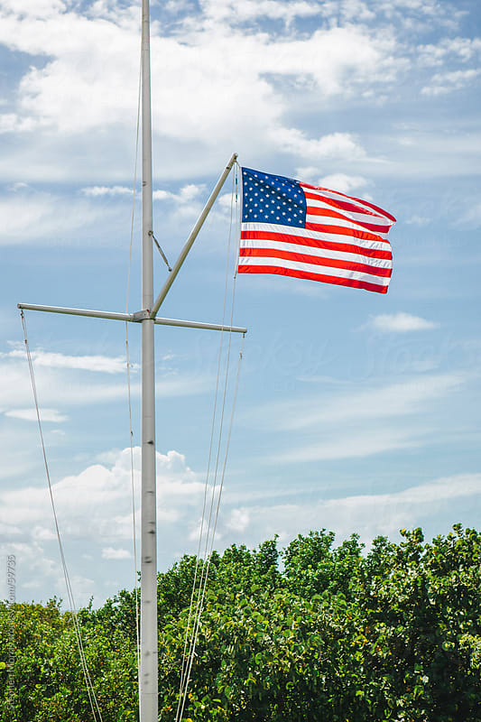 U.S. Flag Flying on a Sailing Mast by Stephen Morris for Stocksy United
