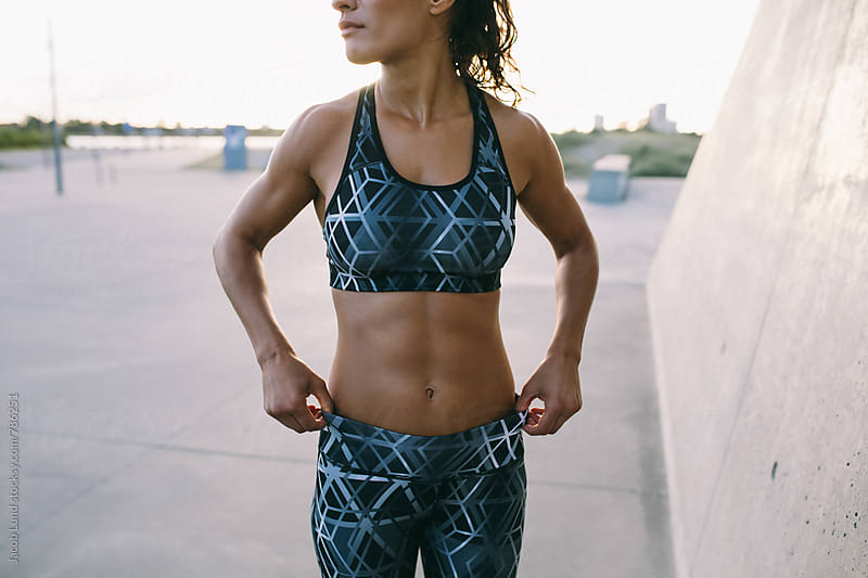 Fit woman in sportswear by Jacob Lund for Stocksy United