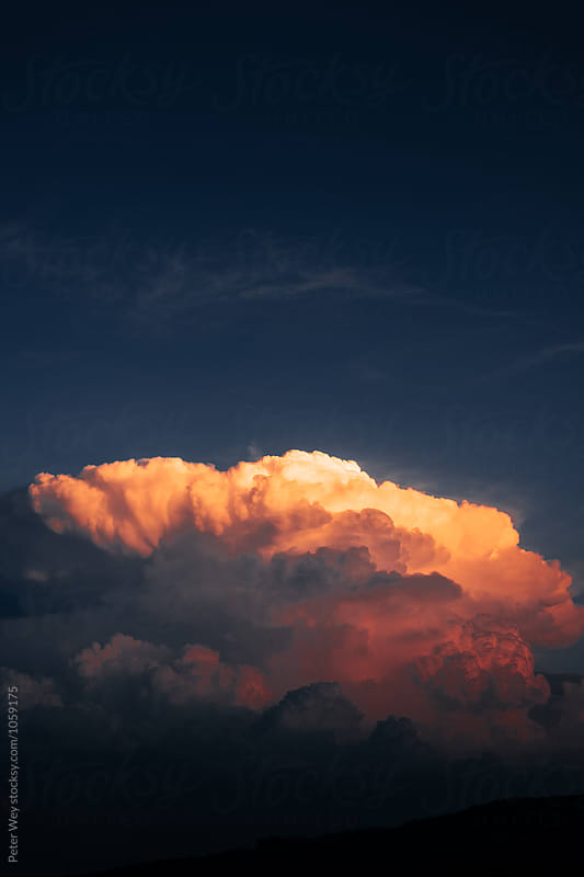 Cumulus clouds at sunset by Peter Wey for Stocksy United