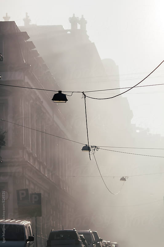 foggy morning in the city, buildings, cars, atmosphere, architecture by Igor Madjinca for Stocksy United