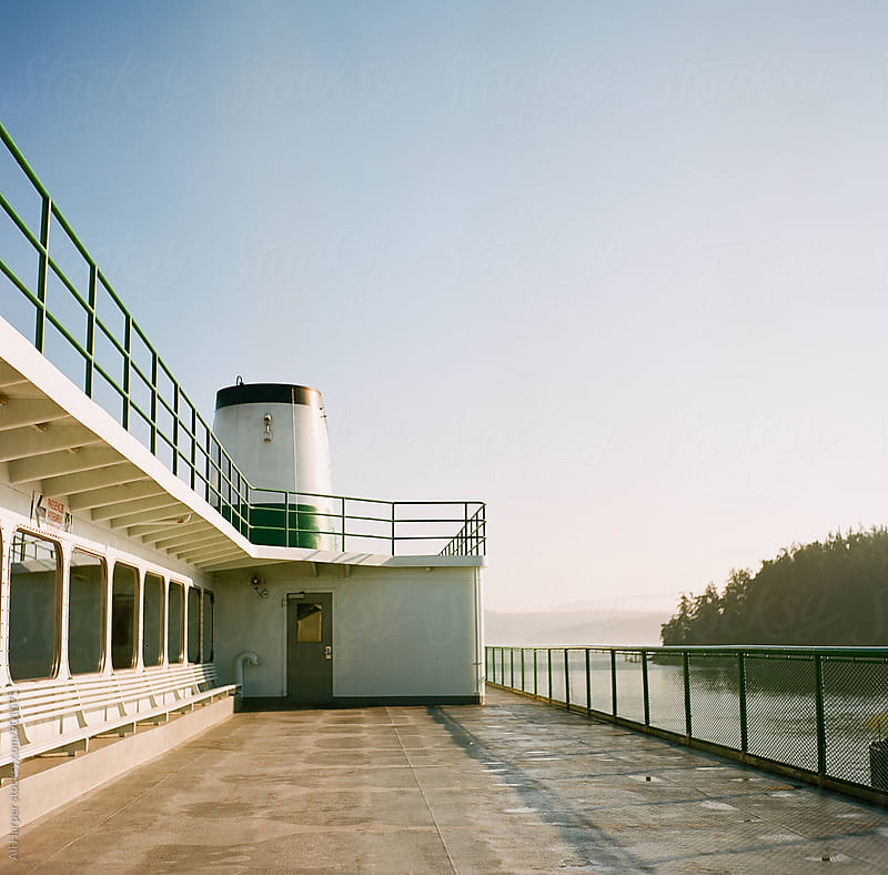 Sunrise on ferry by Ali Harper for Stocksy United