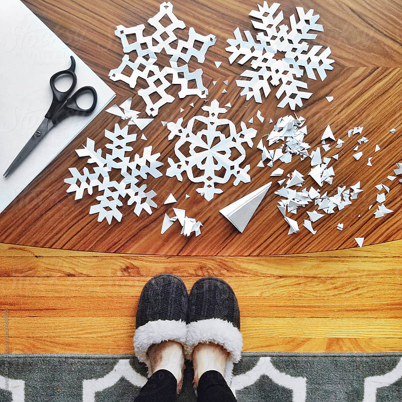 making paper snowflake crafts by Amanda Large for Stocksy United