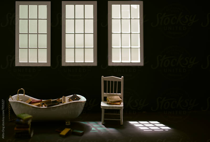 Bathtub and books by Alita Ong for Stocksy United