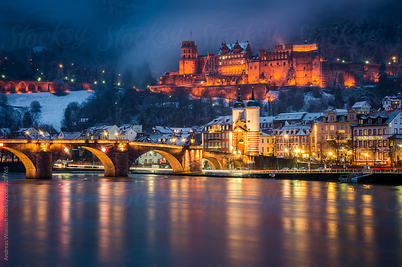 Heidelberg City with Castle and Old Bridge during a Winter Evening by Andreas Wonisch for Stocksy United