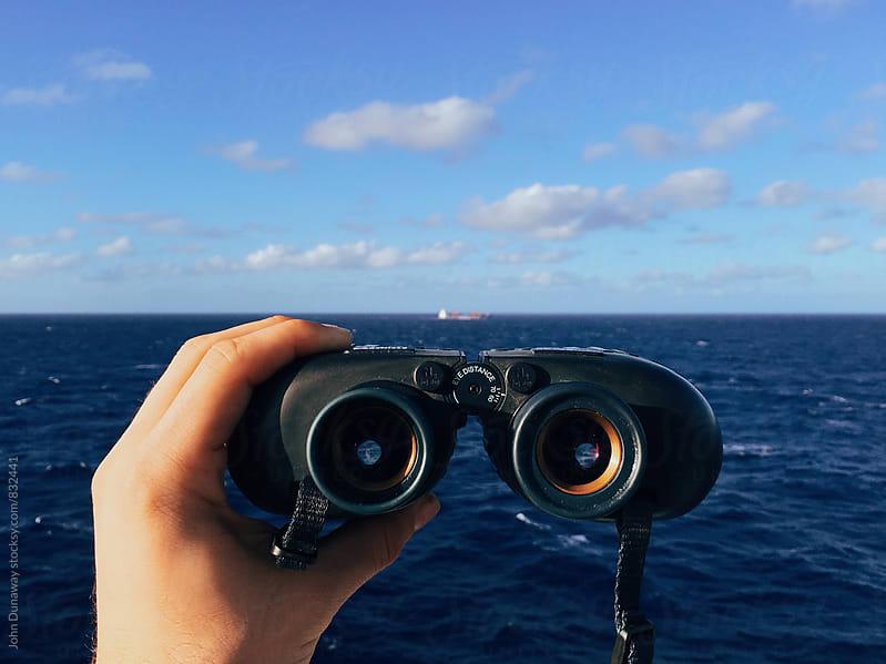 Binoculars on the ocean by John Dunaway for Stocksy United