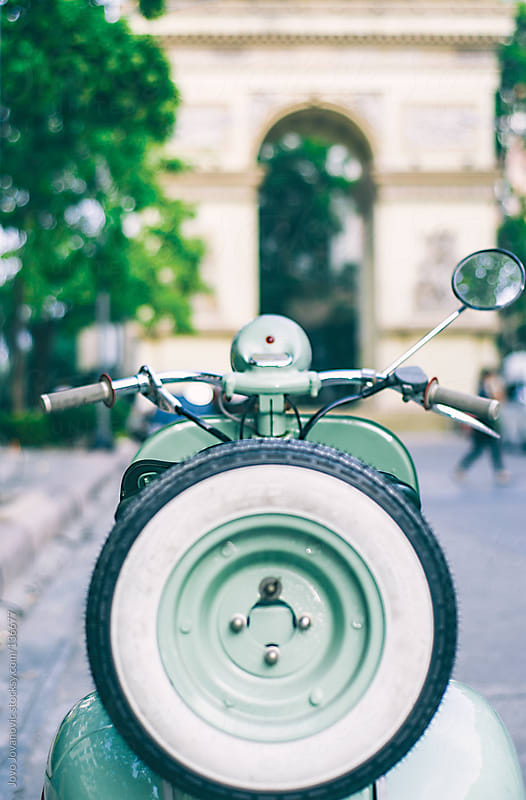 Vintage scooter parked on the street. by Jovo Jovanovic for Stocksy United