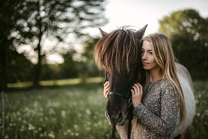 a girl cuddles her horse by Christian Zielecki for Stocksy United