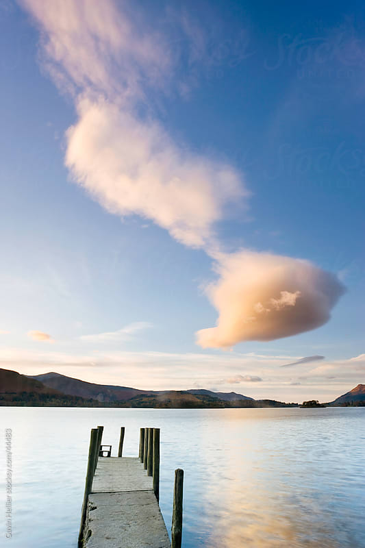 Cloud formation and wooden jetty at Barrow Bay landing, Derwent Water, Lake District National Park, Cumbria, England, United Kingdom by Gavin Hellier for Stocksy United