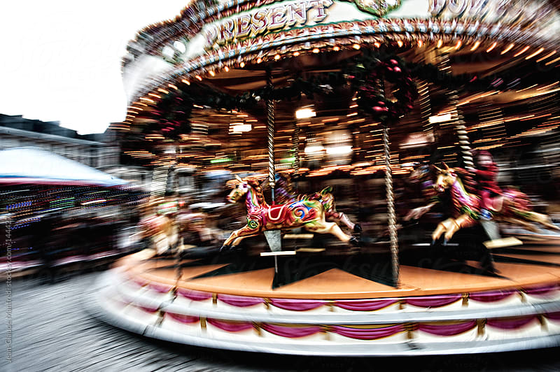 Carousel in motion in Bruges, Belgium, during the Christmas holidays by Jean-Claude Manfredi for Stocksy United