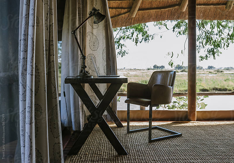 Cozy workspace in african safari house by Trent Lanz for Stocksy United