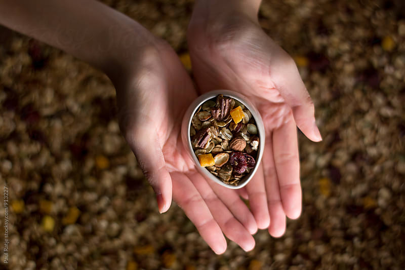 Granola in my hands by Paul Ratje for Stocksy United